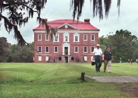 Visitors walked toward the Ashley River at Drayton Hall Plantation.